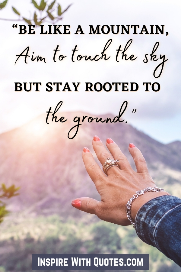 A hand reaching for a mountain with a quote about reaching for the sky like the mountains