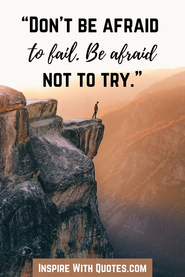 person standing at a mountian peak with quote about being afraid not to try