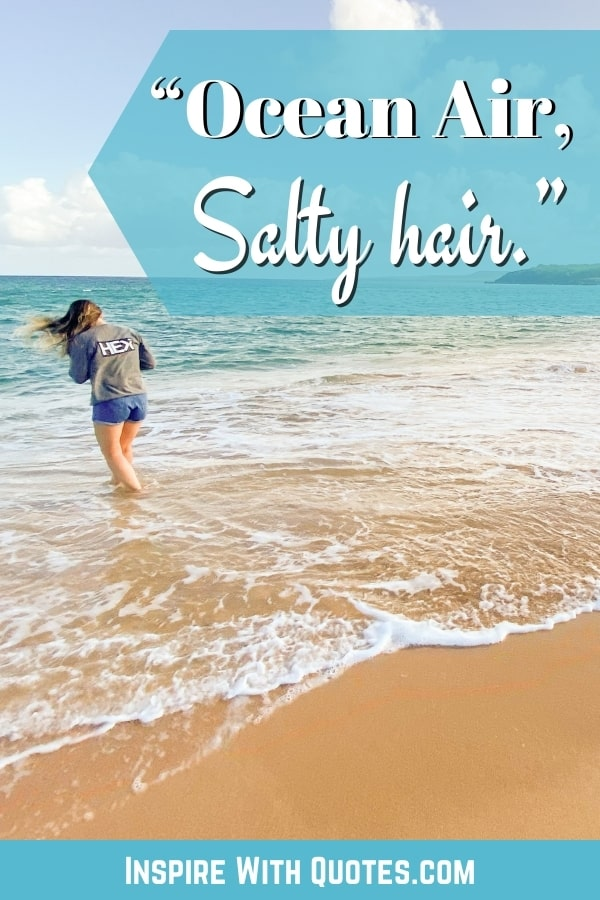 """lady walking into the walk at the beach with the short quote """"ocean air, salty hair"""""""