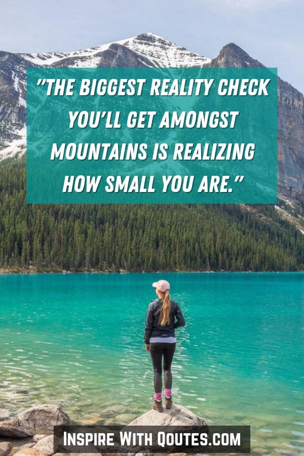 lady standing looking at mountains with quote about feeling small amongst mountains