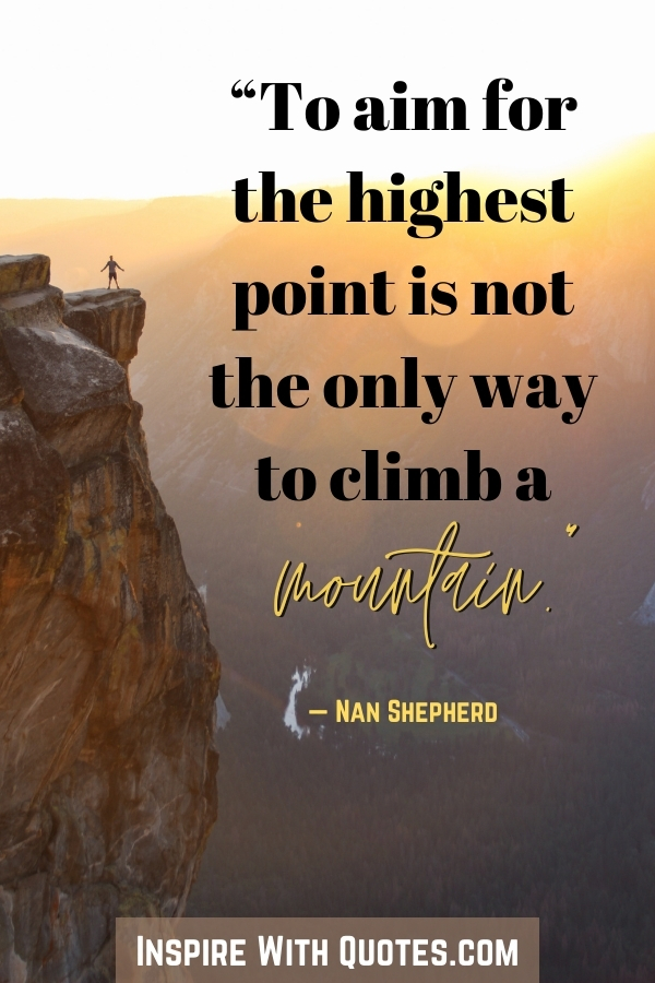 """person in the distance on a mountian with the quote """"to aim for the highest point is not the only way to climb a mountain"""""""
